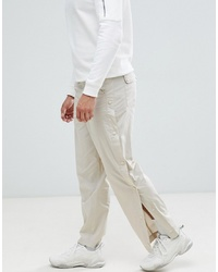 ASOS DESIGN Relaxed Trousers In Beige With Side Poppers