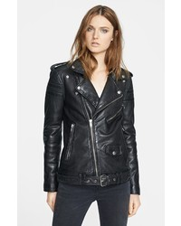 This combo of black leggings and a biker jacket gives off a very casual and approachable vibe.