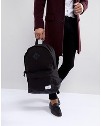 ASOS DESIGN Backpack In Black Canvas With Faux Leather Base