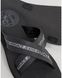 1cdaf95ee ... Versace Jeans Logo Crossover Flip Flop In Black ...