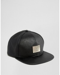 Snapback cap in black faux leather with metal badge medium 1033713