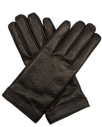 Signature leather gg debossed gloves medium 719620