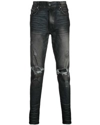 Amiri Ripped Faded Jeans