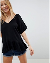 ASOS DESIGN Ruffle Hem T Shirt In Crinkle