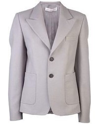 This combination of a white button shirt and a jacket is perfect for a night out or smart-casual occasions.