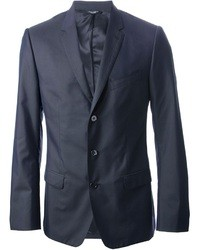 Marry a dark grey rollneck with a blazer jacket to create a smart casual look.