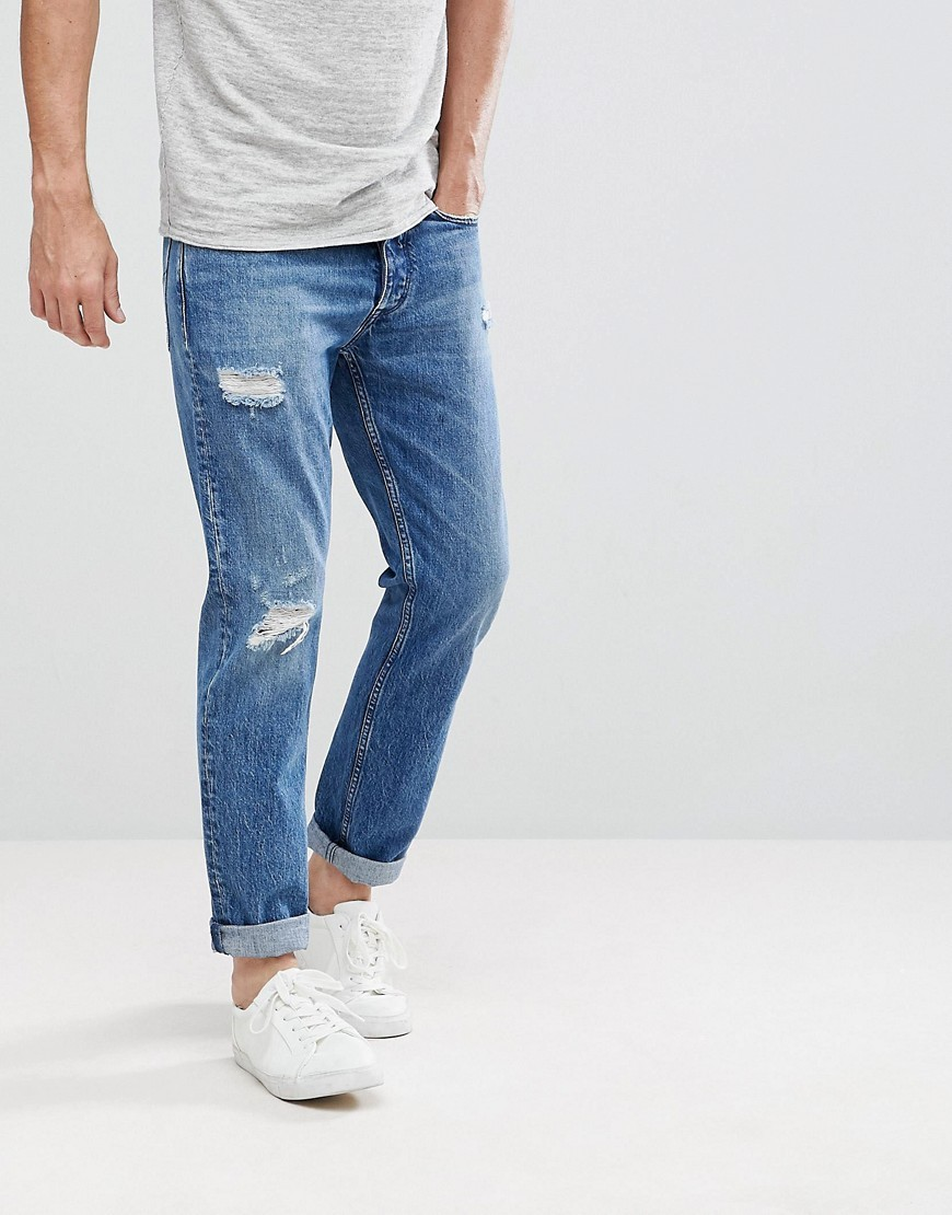 Calvin Klein Jeans Tapered Rip And Repair Jeans