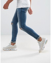 ASOS DESIGN Asos Extreme Super Skinny Jeans In Mid Wash With Rips And