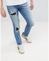 ASOS DESIGN Asos Skinny Jeans In Mid Wash Blue With Rip Repair