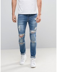 ASOS DESIGN Asos Super Skinny Jeans With Mega Rips In Mid Blue