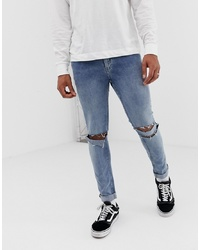Cheap Monday Skinny Tight Jeans In Sacred Blue With Knee Rips