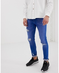 ASOS DESIGN Super Skinny Jeans In Bright Blue Wash With Rips