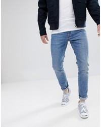 ASOS DESIGN Skinny Jeans In Vintage Mid Wash