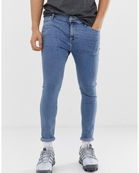 ASOS DESIGN Spray On Jeans In Power Stretch Denim In Light Wash Blue