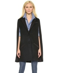 Dress in a cream long sleeve t-shirt and a cape coat for a standout ensemble.