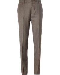 This combination of a tan cardigan and dress pants oozes masculinity and refined elegance.