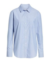 If you're a fan of classic pairings, then you'll like this combination of jeans and a dress shirt.