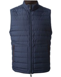 To create an outfit for lunch with friends at the weekend consider wearing dark brown leather work boots and a gilet.