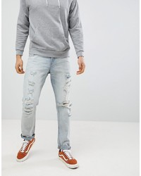ASOS DESIGN Slim Jeans In Light Wash Blue With Heavy Rips