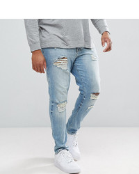 ASOS DESIGN Plus Skinny Jeans In Light Wash With Heavy Rips