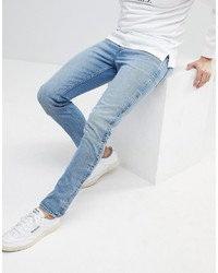 ASOS DESIGN Asos Skinny Jeans In Mid Wash Blue With Popper Detail