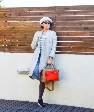 How to wear: black athletic shoes, blue a-line skirt, white horizontal striped crew-neck sweater, grey open cardigan