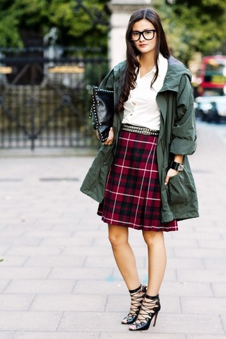How to wear: black leather gladiator sandals, red plaid a-line skirt, white dress shirt, dark green anorak