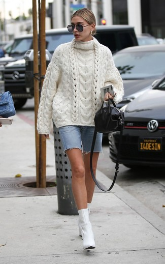 How to Wear a White Knit Oversized Sweater: Go for a white knit oversized sweater and a light blue denim bermuda shorts if you wish to look laid-back and cool without trying too hard. If you need to effortlesslly elevate your outfit with one piece, complement your ensemble with a pair of white leather ankle boots.