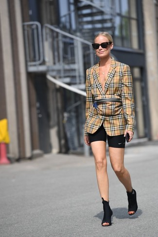 How to wear: tan plaid fanny pack, black elastic ankle boots, black bike shorts, tan plaid blazer