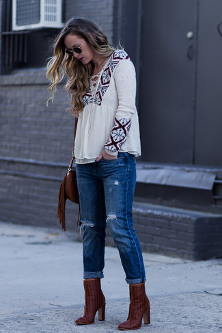 How to wear: dark brown fringe leather crossbody bag, burgundy leather ankle boots, blue ripped boyfriend jeans, beige print peasant blouse