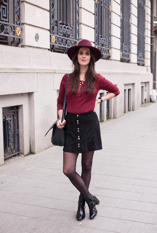 How to wear: black leather crossbody bag, black leather ankle boots, black button skirt, burgundy long sleeve t-shirt