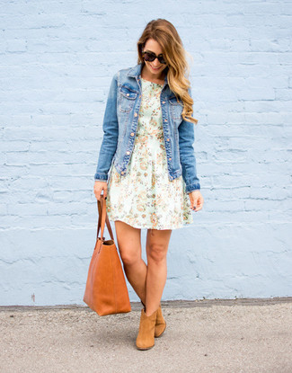 How to Wear Tan Suede Ankle Boots: A blue denim jacket and a mint floral fit and flare dress are amazing staples that will integrate nicely within your current styling rotation. To add some extra flair to your look, add a pair of tan suede ankle boots to the equation.