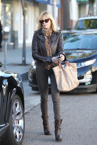 How to wear: tan canvas tote bag, black leather ankle boots, grey jeans, black leather biker jacket