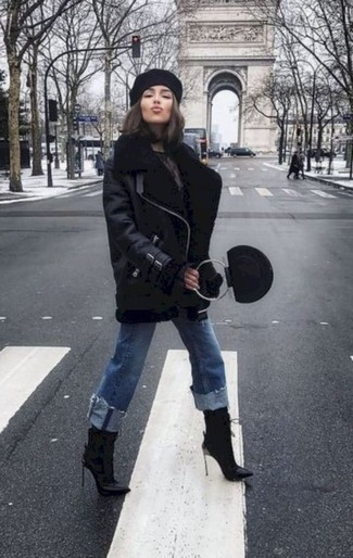 How to wear: black leather handbag, black leather ankle boots, blue jeans, black shearling jacket