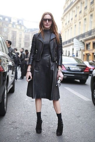 How to wear: black socks, black cutout suede ankle boots, black leather midi dress, black leather biker jacket