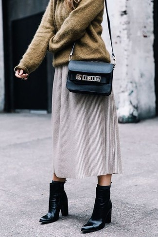How to wear: black leather crossbody bag, black leather ankle boots, grey wool midi skirt, brown oversized sweater