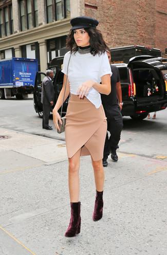 How to wear: gold crossbody bag, burgundy velvet ankle boots, beige slit pencil skirt, white crew-neck t-shirt