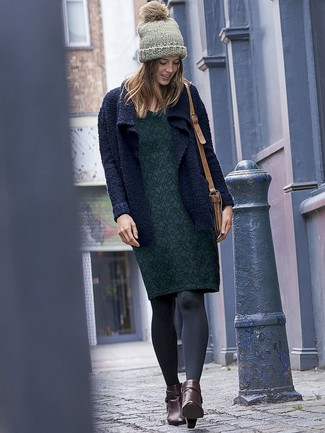 How to wear: tan leather crossbody bag, dark brown leather ankle boots, dark green floral sheath dress, navy knit open cardigan
