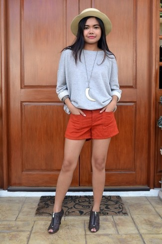 How to wear: khaki straw hat, dark brown cutout leather ankle boots, orange shorts, grey sweatshirt