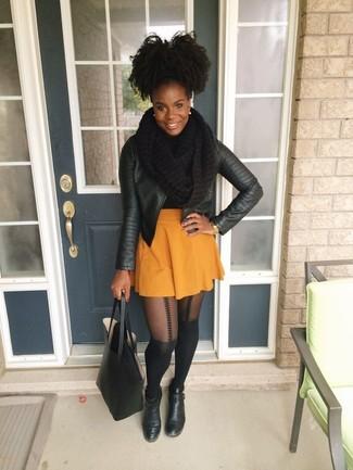 How to wear: black leather tote bag, black leather ankle boots, orange skater skirt, black leather biker jacket