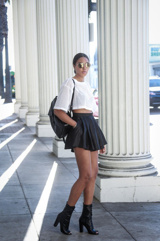 How to wear: black leather backpack, black cutout leather ankle boots, black leather skater skirt, white mesh crew-neck t-shirt