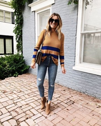 How to wear: brown leather crossbody bag, tan suede ankle boots, navy ripped skinny jeans, tan horizontal striped crew-neck sweater