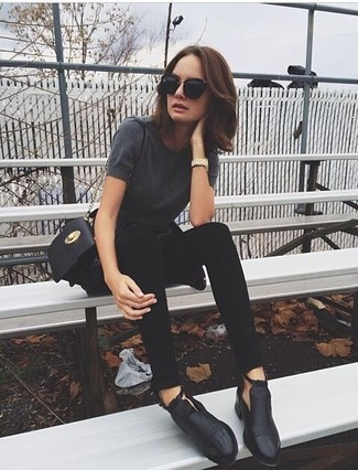 How to wear: black leather crossbody bag, black cutout leather ankle boots, black skinny jeans, charcoal crew-neck t-shirt
