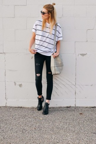 How to wear: grey canvas tote bag, black cutout leather ankle boots, black ripped skinny jeans, white and black horizontal striped crew-neck t-shirt