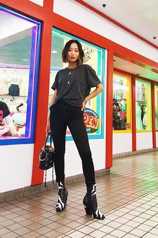 How to wear: black leather handbag, black and white leather ankle boots, black skinny jeans, charcoal crew-neck t-shirt