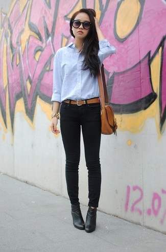 How to wear: brown leather crossbody bag, black leather ankle boots, black skinny jeans, light blue dress shirt