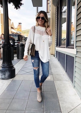 How to Wear a White Lace Long Sleeve Blouse: The versatility of a white lace long sleeve blouse and navy ripped skinny jeans guarantees you'll always have them on regular rotation. Make your outfit a bit smarter by finishing with grey suede ankle boots.
