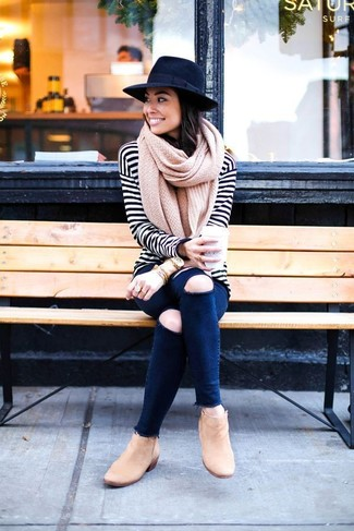 How to wear: black wool hat, tan suede ankle boots, navy ripped skinny jeans, white and black horizontal striped long sleeve t-shirt