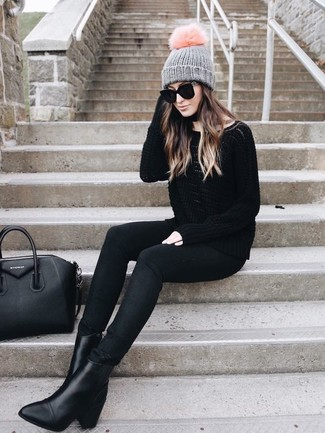 How to wear: black leather tote bag, black leather ankle boots, black skinny jeans, black oversized sweater