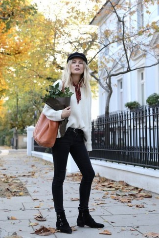 How to wear: tobacco leather tote bag, black suede ankle boots, black skinny jeans, white oversized sweater